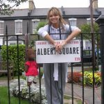 Bearsac and Kara Tointon by Albert Square sign