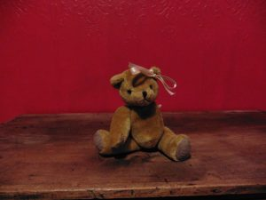 Girl teddy bear with bow on ear
