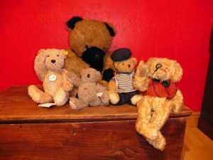 Group of teddies, some with powerful raised arms