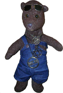 Bearsac wearing dungarees with one strap down.