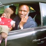 Ex Arsenal footballer Patrick Vieira holding Bearsac in his car window.