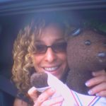 Actor Tracy-Ann Oberberman holding Bearsac and waving hi paw.