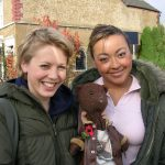 Actresses Kelly Adams & Jaye Jacobs holding Bearsac