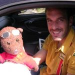 Manuel Almunia holing Bearsac in his car