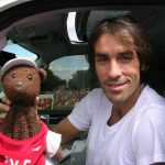Robert Pires holing Bearsac in his car