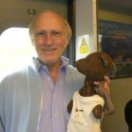 Colin Berry holding Bearsac on train