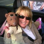 Actor Leticia Dean holding Bearsac in her car