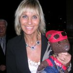Actor Linda Haydon holding Bearsac