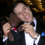 Singer Paul Pashley holding Bearsac