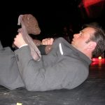 Tony Benedict lying on stage holding Bearsac