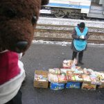 Russian babushka on platform. Bearsac at side