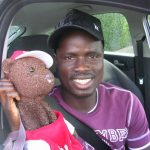 Emmanuel Eboue holding Bearsac in car window
