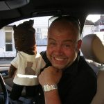 Cliff Parisi holding Bearsac in his car