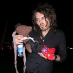 Russell Brand holding Bearsac like a baby