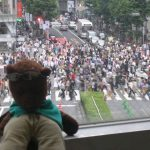 Bearsac in foreground of Shibuya crossing during pedestrians turn
