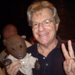 Jerry Springer holding Bearsac