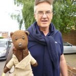 Larry Lamb holding Bearsac