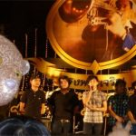 Boy band Lao Lome with Bearsac at side of frame.