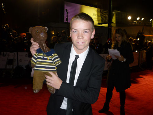 Will Poulter holding Bearsac