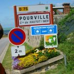 Bearsac looking at place sign for Pourville.