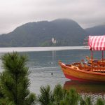 Tourist boat at moor on Lake Bled