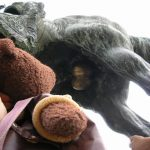 Bearsac looking up at the brass balls of a horse statue