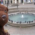 Bearsac beside a low fountain in Zagreb