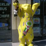 Bearsac and family on paw of Berlin's United Buddy Bear