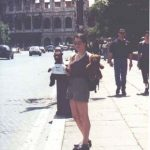 Debra holding Bearsac and Rizla with the Colosseum in background