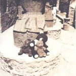 Bearsac, Choc-Ice and Rizla sitting on a mill stone in Pompeii