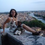 Debra and Bearsac on a wall with high view of Verona
