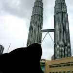 Bearsac with his muzzle tuned up towards the Petronas Towers