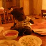 Bearsac sitting on table with Polish food.