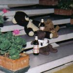 Bearsac, Choc-Ice and Rizla, with beer bottles on hotel stairs