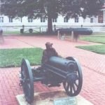 Bearsac sitting on a cannon