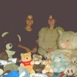 Bearsac and Choc-Ice with lots of other teddies, and Debra and the teddy bears' owner.