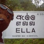 Bearsac in front a Ella place sign