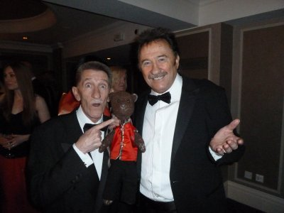 Chuckle Brothers holding Bearsac between them