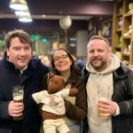 Debra and Bearsac with two men in a pub